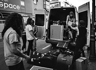 Band loading tour van